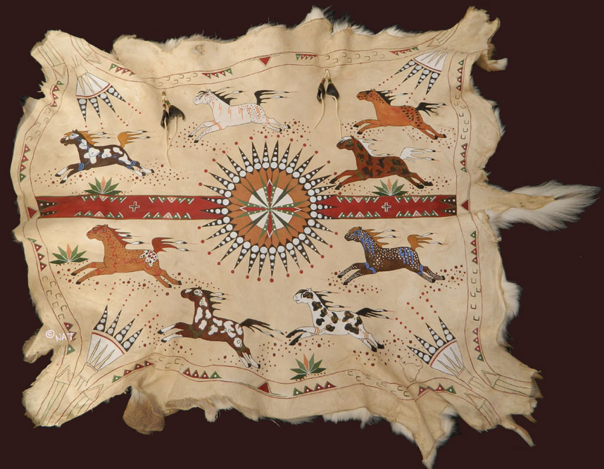 when painting traditional buffalo robes and hides we use earth pigment